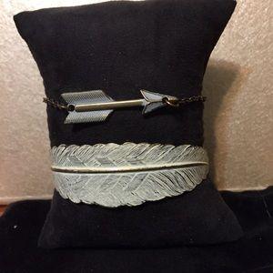 A two bracelet set, a feather cuff & arrow chain